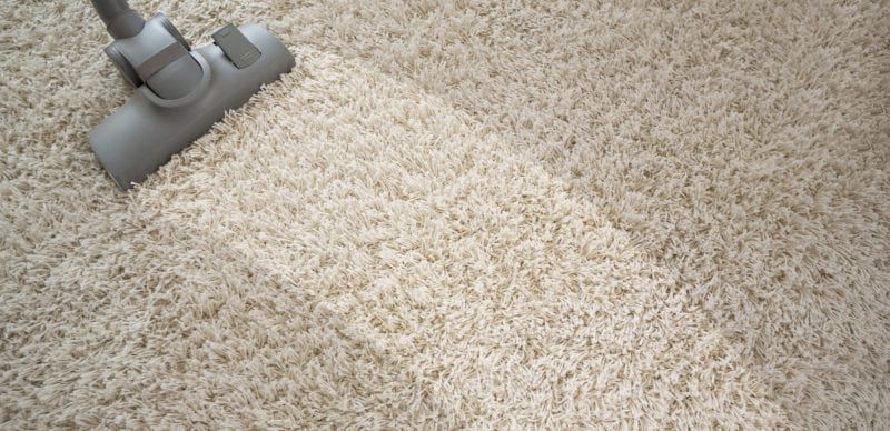 Vacuuming rough carpet with vacuum cleaner